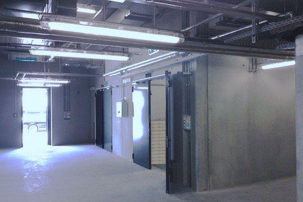 Portes et portails coupe-feu avec des ensembles de blocage ATEX